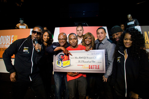 McDonald's 2012 Flavor Battle Champion, San Francisco-based DJ Risk One, celebrates victory in Miami and was presented with a check for $10,000 by McDonald's U.S. marketing director Rob Jackson along with hosts Doug E. Fresh and actress/singer Teyana Taylor.  (PRNewsFoto/McDonald's)