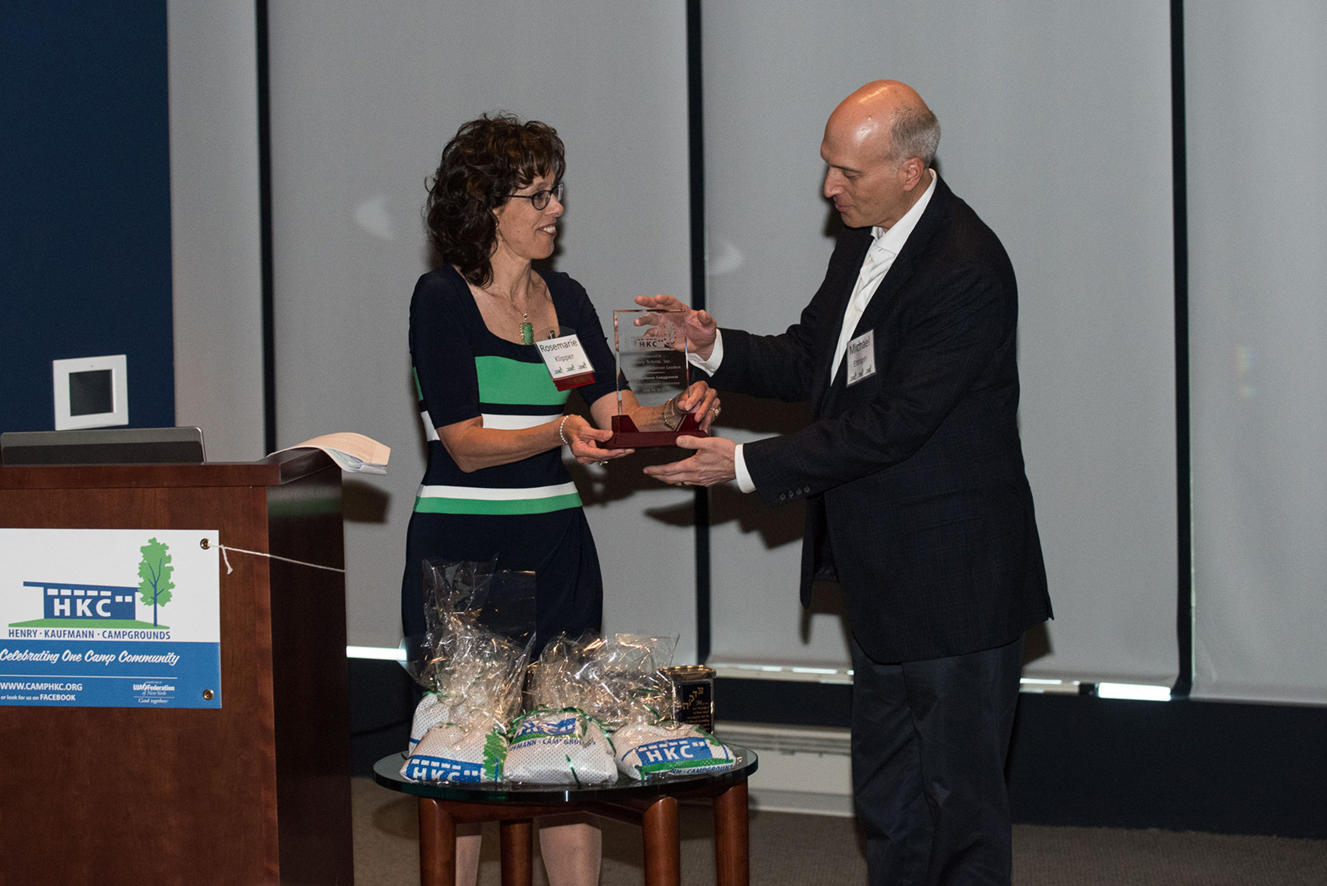 Michael S. Ettinger, Senior Vice President of Corporate & Legal Affairs, Henry Schein, Inc., accepted the Henry Kaufmann Campgrounds (HKC) Corporate Leader Award on behalf of Henry Schein. Rosemarie Klipper, HKC Board Member, presented the award on June 10 at the organization's Annual One Camp Community Celebration held at Citi Field in New York City.