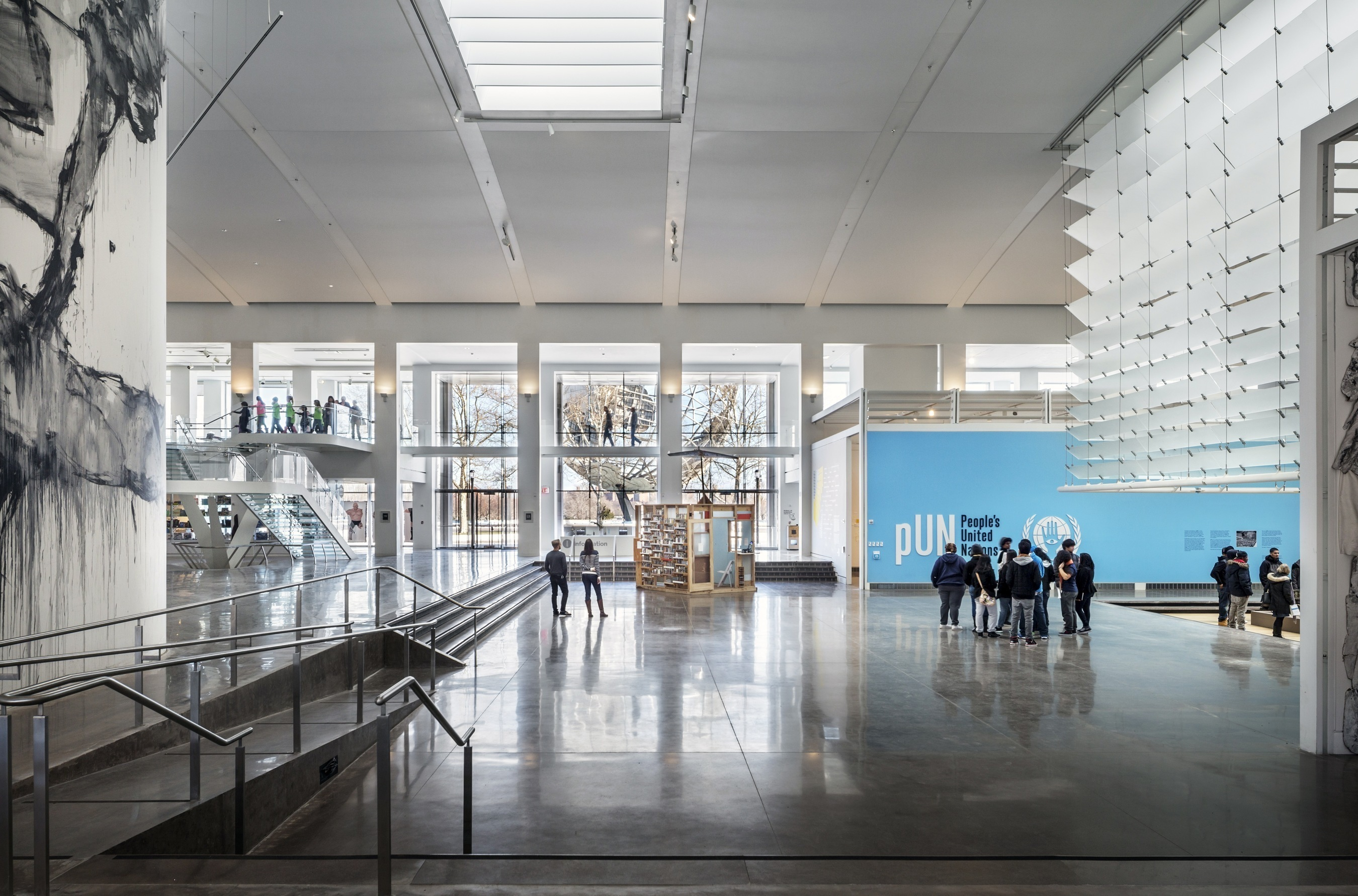 Main floor at Queens Museum with its glass staircase and stunning view of the Unisphere. (PRNewsFoto/Amerivents)