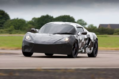 A Detroit Electric SP:01 electric sports car, under a non-production prototype body, undergoes dynamic testing at a facility in Europe.