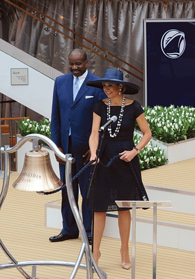 Her Majesty Queen Maxima of the Netherlands rings the bell of ms Koningsdam - the newest cruise ship for Carnival Corporation and one of its 10 brands, Holland America Line - after officially blessing the bell with a glass of champagne, with Orlando Ashford, president of Holland America Line, watching her do the honors.