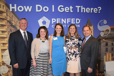 Ed Grenier (left), president and CEO of Junior Achievement of Greater Washington, and James Schenck (far right), president and CEO of PenFed Credit Union, meet with JA staff at PenFed's educational branch inside JA Finance Park of Prince George's County.