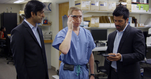 Developers Divya Mahajan from Philips and Brent Blum from Accenture instruct Dr. David Feinstein in how to use the Google Glass connected to IntelliVue monitoring. (PRNewsFoto/Philips Healthcare)