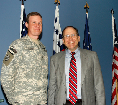SSgt Jason Barber with IDB President Mark Cramer at the North Carolina Military Academy.  (PRNewsFoto/Institute for Defense & Business)