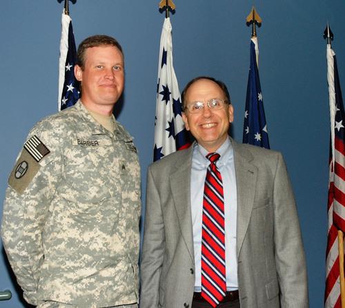 SSgt Jason Barber with IDB President Mark Cramer at the North Carolina Military Academy.  (PRNewsFoto/Institute  ...