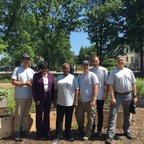Representatives from The Children's Hospital of Philadelphia, Philadelphia City Council, the Democratic National Convention Committee, credit unions and RealClearPolitics gather at the Nicholas and Athena Karabots Pediatric Care Center to build a Health and Wellness Garden.