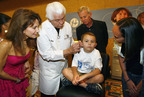 Susan Lucci, All My Children (left) joins Bill Austin, Founder, Starkey Hearing Foundation (center), as well as Tristan Rogers, General Hospital (center right) as they provide the gift of hearing to a patient at the Starkey Hearing Foundation Las Vegas Mission. More than 100 children and adults were fitted with a custom-made hearing aid. Other guests included actress Marlee Matlin, actress and The View co-host, Sherri Shephard, comedian and host, Wayne Brady, television actors and singers Kyle and Chris Massey. (PRNewsFoto/Starkey Hearing Foundation)