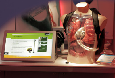 The SynCardia temporary Total Artificial Heart powered by the Freedom(R) portable driver in the Backpack is being featured as part of the $3 million Bodyworks Exhibition at the Glasgow Science Centre in Scotland.  (PRNewsFoto/SynCardia Systems, Inc.)