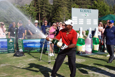 Alfonso Ribeiro sprays the crowd with Korbel California Champagne after popping the cork and winning the 2010 Korbel Long Drive Competition with a 333-yard drive. The competition was held on July 16, 2010 as part of the American Century Celebrity Golf Championship in Lake Tahoe, NV.  (PRNewsFoto/Korbel Champagne Cellars)