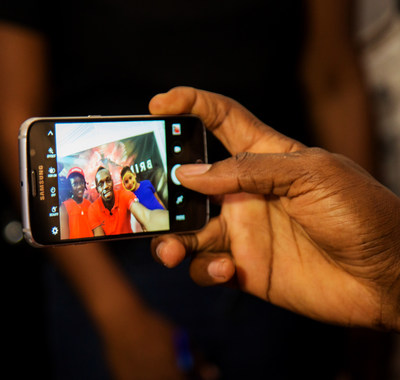 "Having asked if Usain would be friends with him on Facebook, seven year-old Ajani Brown from Jamaica scores a selfie with Usain Bolt and kiddie moderator for the Digicel ""Bring the Beat"" press conference, nine year-old Naleighna-Kae McLean."