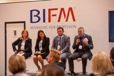 Facilities Managers  discussing important issues at Facilities Show, London ExCel, June 2014