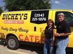 Tammy and Glenn Garrett outside their new Dickey's Barbecue Pit catering van in Hillsboro. The location opens Thursday with a three day grand opening celebration. (PRNewsFoto/Dickey's Barbecue)