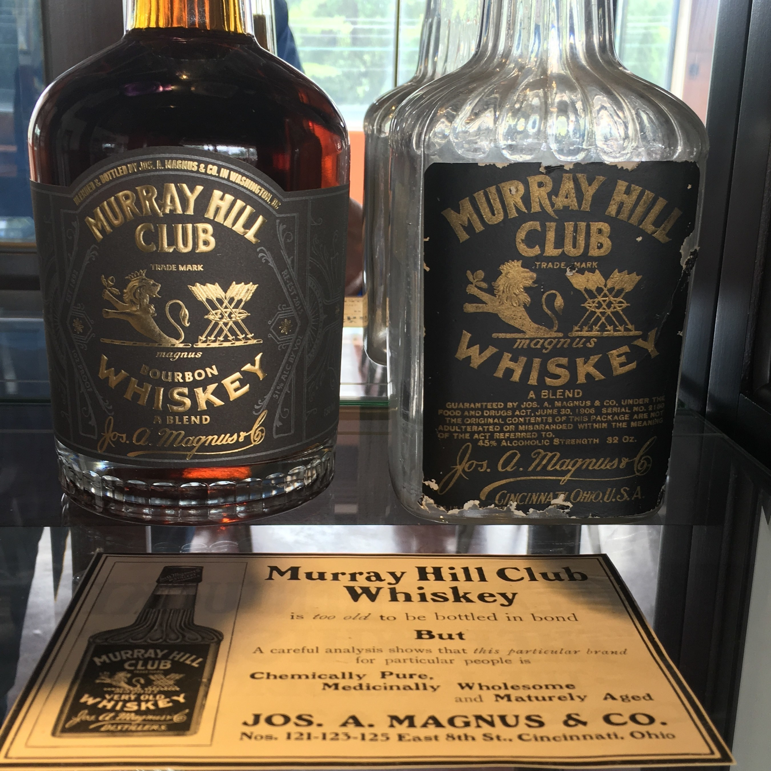 New Murray Hill Club Blended Bourbon Whiskey next to original 1890s Murray Hill Club bottle.