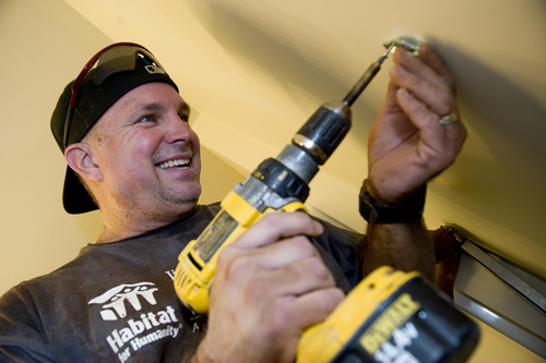 Garth Brooks Helps Build and Repair Houses in Birmingham During Annual Habitat for Humanity Jimmy