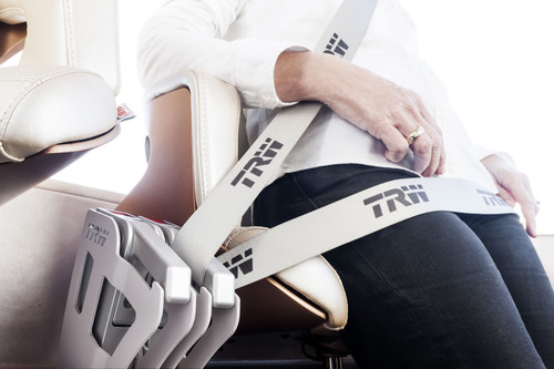 TRW is unveiling a new seat belt system concept that offers semi-automatic buckling versus the traditional buckle and tongue, helping to increase belt usage rates over short distances for the urban commuter vehicles of the future.  (PRNewsFoto/TRW Automotive Holdings Corp.)