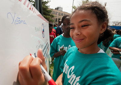 Children in The Action Center's summer program in Far Rockaways, N.Y., line up to sign the preparedness pledge a Save the Children Prep Rally. Photo by Susan Warner of Save the Children. (PRNewsFoto/Save the Children)