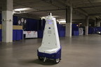 The Vigilant mobile security robot on patrol protecting the exhibits at a trade show. These autonomous robots are American made and designed for night security in warehouses, data centers, and shopping malls. (PRNewsFoto/Gamma 2 Robotics, Inc.)