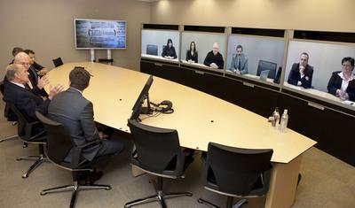 His Royal Highness, The Duke of Edinburgh, visits Teliris for a private demonstration of telepresence technology.  (PRNewsFoto/Teliris)