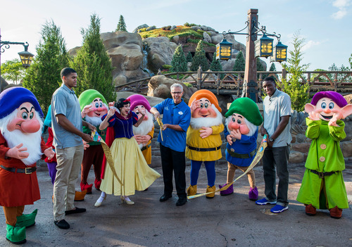 Seven Dwarfs Mine Train Officially Opens at Walt Disney World Resort: Snow White and the Seven Dwarfs join Phil Holmes (center), vice president of Magic Kingdom Park, and Orlando Magic players Tobias Harris (left) and Victor Oladipo (right) May 28, 2014 to officially open Seven Dwarfs Mine Train to Walt Disney World Resort guests. Representatives of Big Brothers Big Sisters of Central Florida were also in attendance to commemorate the occasion. The attraction completes New Fantasyland, the largest expansion in Magic Kingdom history. Magic ...