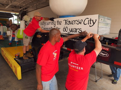 "Members of the DTE Energy volunteer Care Force assemble the DTE float that will appear Friday in the DTE Energy Foundation Cherry Royale Parade. The float's theme is ""Committing Our Energy to Traverse City."""