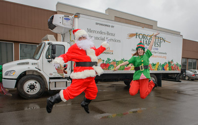 Santa and his elf were happy to help Mercedes-Benz Financial Services present a new 2016 clean diesel Freightliner refrigerated truck to Forgotten Harvest just in time for the holidays.