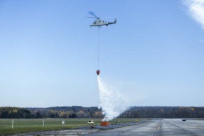 The unmanned K-MAX helicopter successfully conducted a firefighting mission during a demonstration on Nov. 6. Aided by the small unmanned Indago quad rotor, unmanned K-MAX extinguished several fires while collecting and dropping more than 24,000 pounds of water onto the flames in one hour.