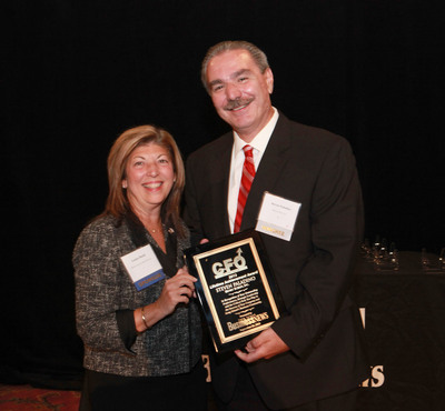 "Steven Paladino, Executive Vice President and Chief Financial Officer, Henry Schein, Inc., received the Long Island Business News ""CFO Lifetime Achievement Award."" Louise Duchi, Senior Vice President, Commercial Banking, Bank of America Merrill Lynch, presented Mr. Paladino with the award.  (PRNewsFoto/Henry Schein, Inc.)"