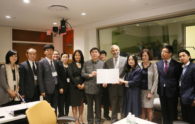 Business representatives and Assistant Secretary-General for Economic Development, Lenni Montiel are holding the signed Commitment Letter to sustainable development