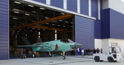 Italy's first built F-35A, aircraft AL-1, which will also be the first jet operated by the Italian Air Force, rolls out of the Cameri, Italy, Final Assembly & Check Out (FACO) facility, Mar. 12. (Lockheed Martin photo by Larry Bramblett)
