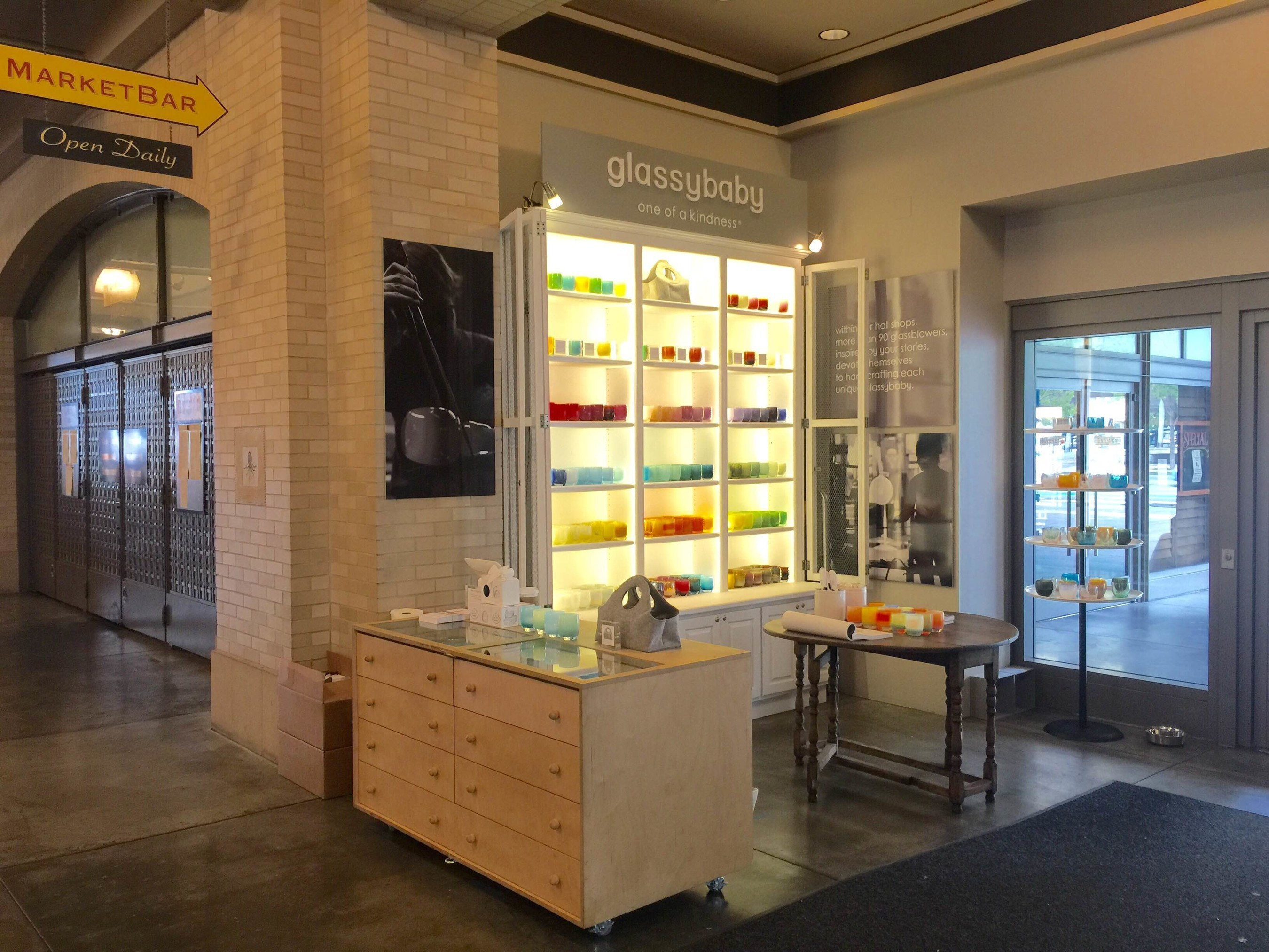 glassybaby, maker of handmade glass votive candleholders and drinkers opens third Bay Area store in San Francisco's historic Ferry Building. Ten percent of all sales of glassybaby products are donated to causes that heal.
