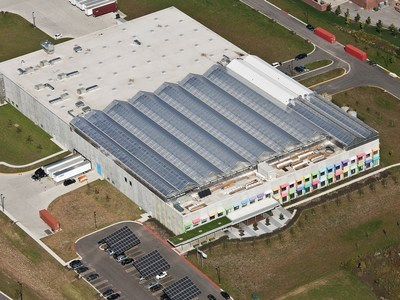 Aerial view of Gotham Greens' 75,000 sq ft rooftop greenhouse located in Chicago's south side Pullman neighborhood. At nearly two acres, the greenhouse is the 'World's Largest' Rooftop Farm, producing over 10 million annual crops while employing over 50 workers. Gotham Greens is the largest urban agriculture company in the world with facilities in New York and Chicago. Photo Credit: Gotham Greens/ McShane Fleming Studio.