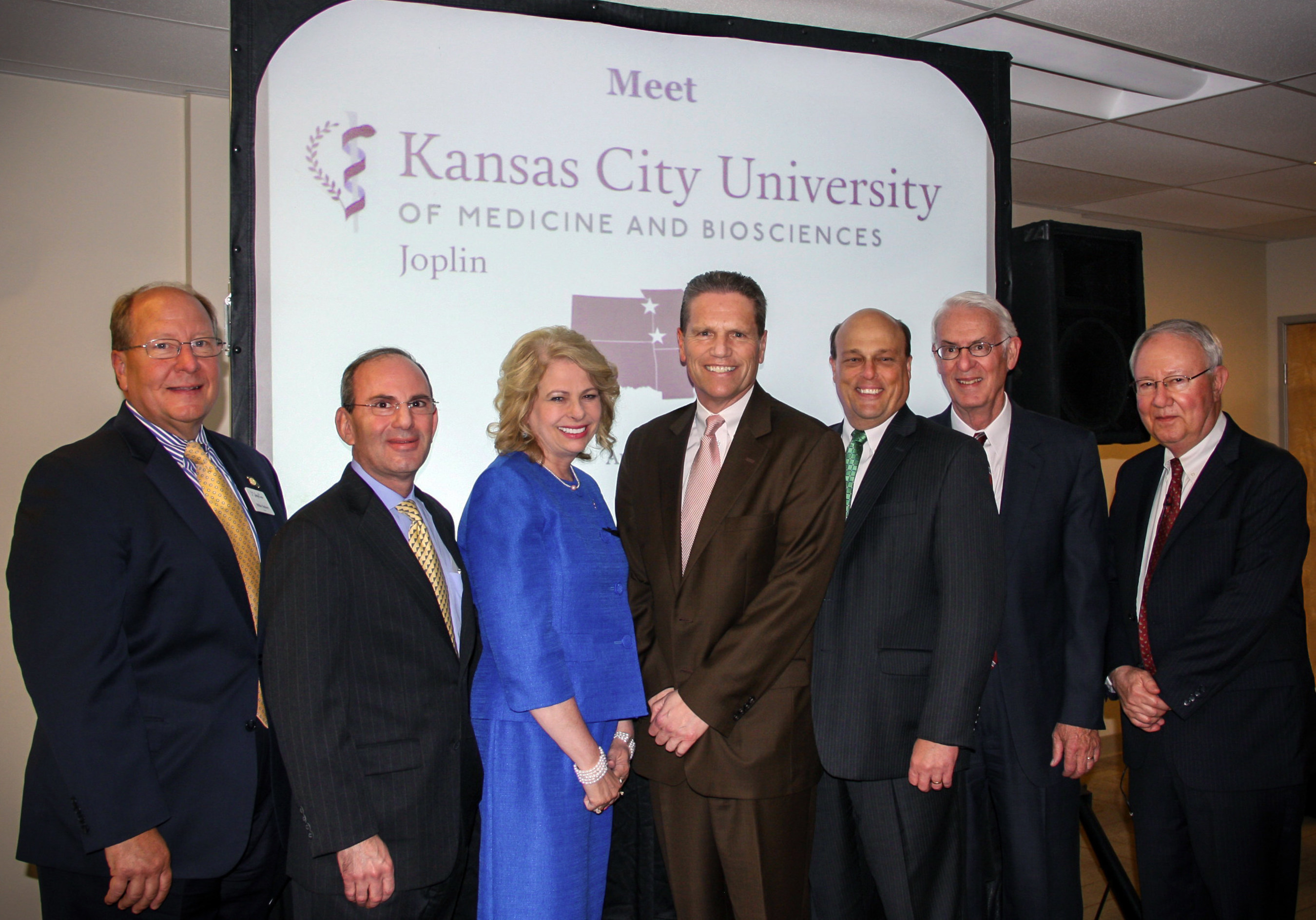 The Kansas City University of Medicine and Biosciences (KCU) partnered with the Joplin community to open the first new medical school in Missouri nearly 50 years: (Left to Right) Michael Siebert, mayor of Joplin, Marc B. Hahn, DO, president and chief executive officer of KCU, Paula Baker, president and chief executive officer of Freeman Health System, Gary Pulsipher, president of Mercy Hospital Joplin, Rob O'Brian, president of the Joplin Area Chamber of Commerce, Larry McIntire, DO, president of the Joplin Regional Medical School Alliance, and Rudy Farber, chairman of Community Bank & Trust.