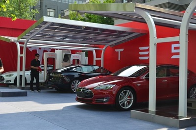 The PV charging systems was requested by Tesla Motors, and designed and manufactured by Hanergy Solar Group