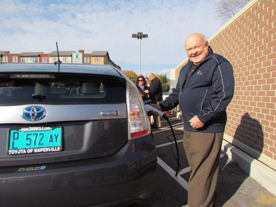 The Mayor of Naperville Poses with a Toyota Prius at the new Naperville, IL Charging Station downtown in the Van Buren Street lot.  (PRNewsFoto/Toyota of Naperville)