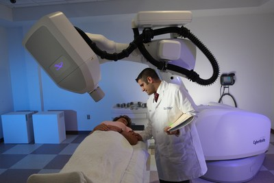 Dr. David D'Ambrosio speaks with a patient in the CyberKnife treatment room at the J. Phillip Citta Regional Cancer Center. (PRNewsFoto/New Jersey CyberKnife)