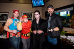 Justin Tucker and Dennis Pitta with Goodwill's Gridiron Halloween party guests (PRNewsFoto/Goodwill Industries)