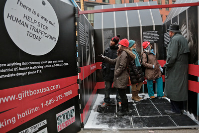 Inside the GIFT Box visitors learn about the harsh realities of human trafficking. (PRNewsFoto/Committee to Stop Trafficking in Persons, Photo Courtesy of Leslie Sternli) (PRNewsFoto/COMMITTEE TO STOP...)