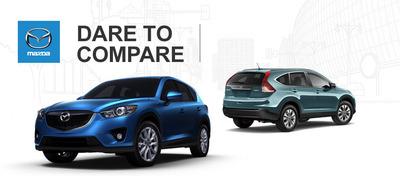 Ocean Mazda compares its 2014 CX-5 compact crossover to the 2014 Honda CR-V on a new web page.  (PRNewsFoto/Ocean Mazda)