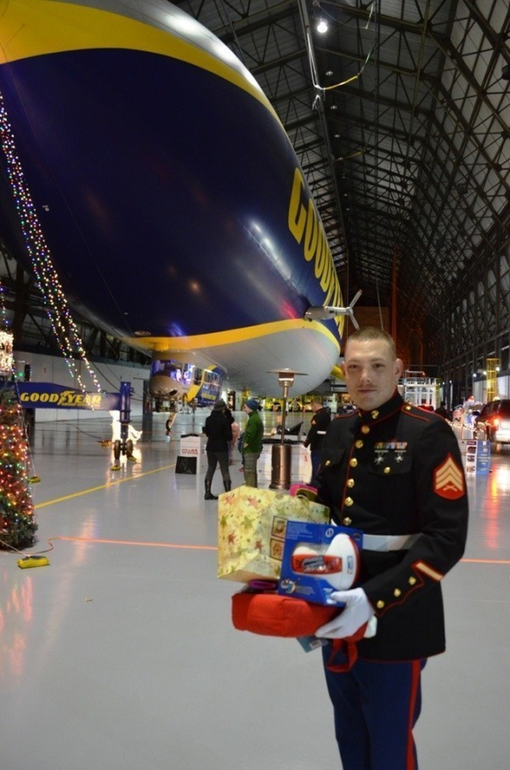 U.S. Marine Sgt. Richard Radtke is all smiles during the 2014 Toys for Tots drive at the Goodyear blimp base in Suffield, Ohio. The Goodyear Tire & Rubber Company's three U.S. blimp bases are gearing up for their fifth annual effort to benefit the Toys for Tots Foundation in 2015.