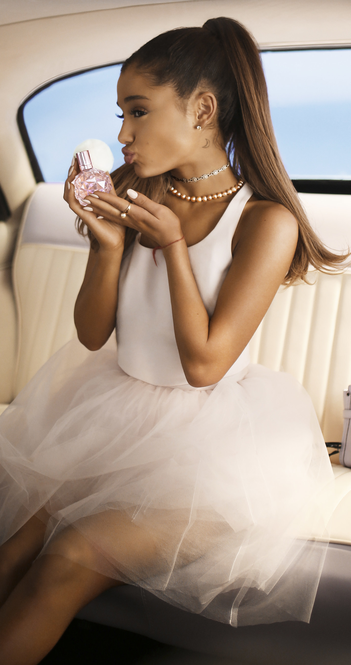 Ariana Grande launches debut fragrance ARI by Ariana Grande in September 2015.