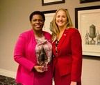 Aflac U.S. President Teresa White (l) is honored by the Healthcare Businesswomen's Association with their 2014 Woman in Healthcare Leadership Award. Pictured right of Mrs. White is Sharon Baldwin, president of the Atlanta Chapter of the HBA.