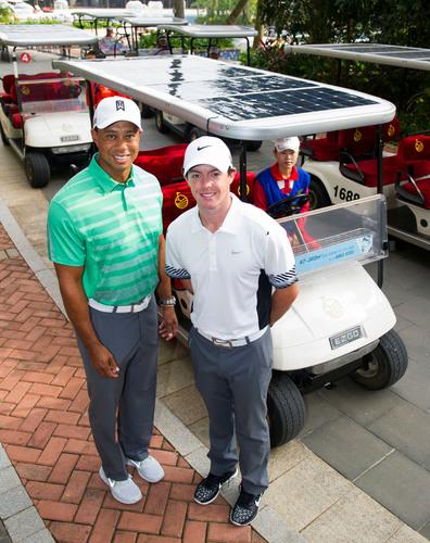 Tiger Woods and Rory McIlroy Enjoy Mission Hills New Solar Powered Golf Cart. (PRNewsFoto/Mission Hills China) (PRNewsFoto/MISSION HILLS CHINA)