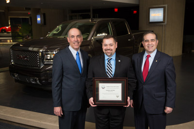 Michigan Veterans Affairs Agency Director Jeff Barnes (center) presents the first-ever Gold-Level Veteran-Friendly Employer Award to General Motors Vice President of U.S. Sales and Service Steve Hill (left) and GM Chief Diversity Officer Ken Barrett, to recognize GM's ongoing efforts to hire and support U.S. military veterans Thursday, November 5, 2015 in Detroit, Michigan. (Photo by John F. Martin for General Motors)