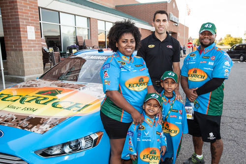 Military Veteran Daniel Wright (Right) with Family and NASCAR Sprint Cup Series Driver Aric Almirola ...