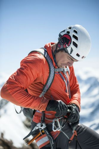 Dani Arnold pushing the stop watch on the summit of the Matterhorn. He sets a new speed record at the North ...