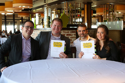 Pinot's Palette founders Craig Ceccanti (far left) and Charles Willis (left center) celebrate the signing of their first international franchise agreement with franchisees Chad M. Smith (center right) and Joanne Christena Smith (far right). The agreement is for as many as eight studios in Canada and makes Pinot's Palette the first paint and sip franchise to expand nationally.