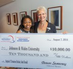 Lorna Donatone, (R) chief operating officer for Sodexo North America, president for Sodexo Education and treasurer for the National Restaurant Association Educational Foundation, presents a $10,000 check to Sade Donald (L) of Simeon Career Academy (Chicago) to further her postsecondary studies in the restaurant and hospitality industry. (PRNewsFoto/The National Restaurant...)