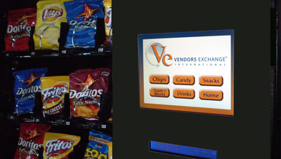 The MIND touch screen showing product categories on the VE REVISION door.