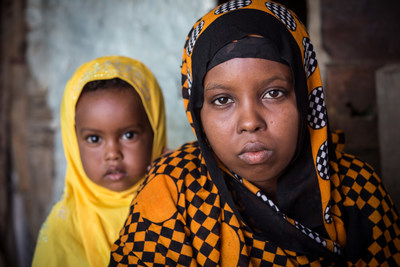 Former child bride Aisha*, 15, with her two year-old daughter Rayan* in their family home in Somalia (*names changed to protect identity). Credit: Colin Crowley/Save the Children