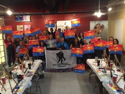 Wounded veterans and their family paint Florida sunsets.